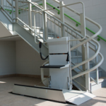 Savaria Omega inclined platform lift installed on curved staircase